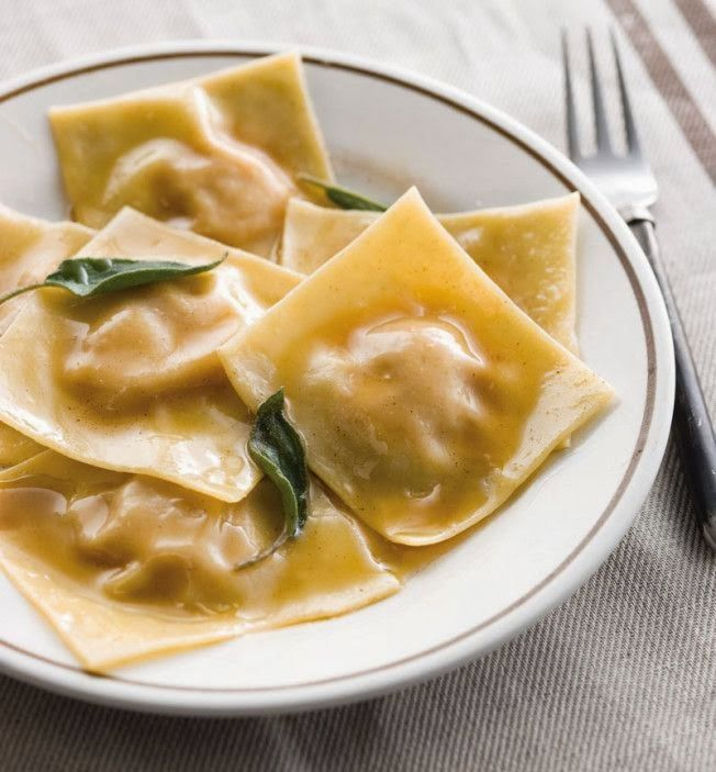 Pumpkin Ravioli with Sage Butter : Italian traditional  The pumpkin ravioli is one of the typical dishes of Mantua and certainly one of the most popular dishes in Italy, also because related to the Christmas tradition: pumpkin ravioli are always the typical first course to be consumed during dinner on Christmas Eve.