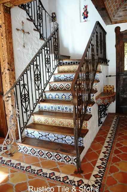 Dreamy Mexican tile stairway. Tile would look beautiful on a fireplace too