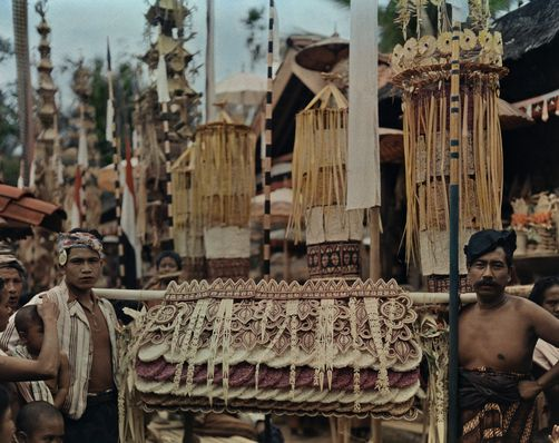 Men carry offerings of rice cakes toward a temple. MAYNARD OWEN WILLIAMS/National Geographic Creative