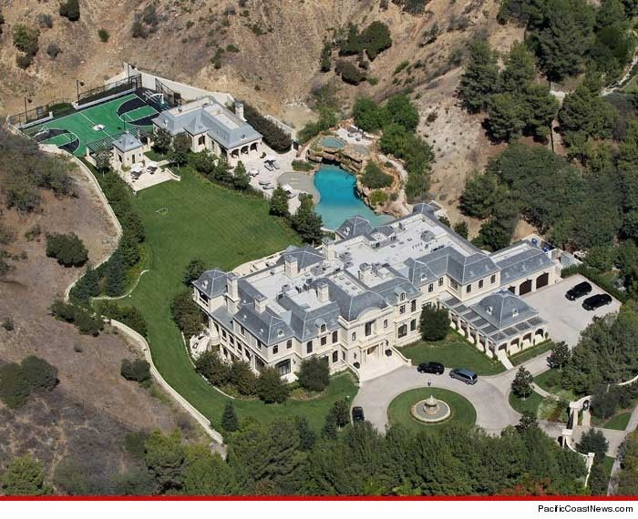Mark Wahlberg's disgustingly excessive estate, just finished, in L.A. When the earth quakes out there, and this thing slides from it's perch, it's all over for everybody below. People in Follywood have no taste and no brains, just money.