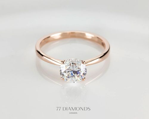round-cut solitaire, rose gold 4-prong this might look nice with a white gold, detailed wedding band...or vice versa (white gold engagement setting, and rose gold wedding band?)