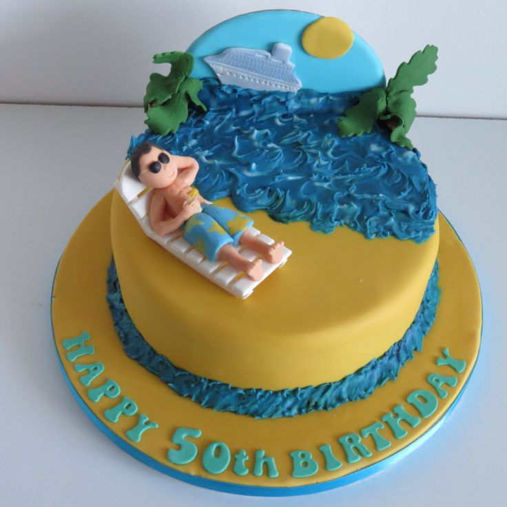 Caribbean Cruise themed fruit cake..with modelled sugar sun bed and sunbather sipping a cocktail with the cruise ship in the background!