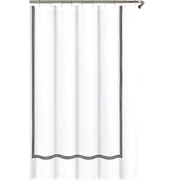 Lend a simply stylish touch to your master bath or powder room with this understated shower curtain, featuring a subtle geometric motif in neutral hues. Pair it with bamboo shelves for a breezy look, then anchor the ensemble with a simple bath mat.