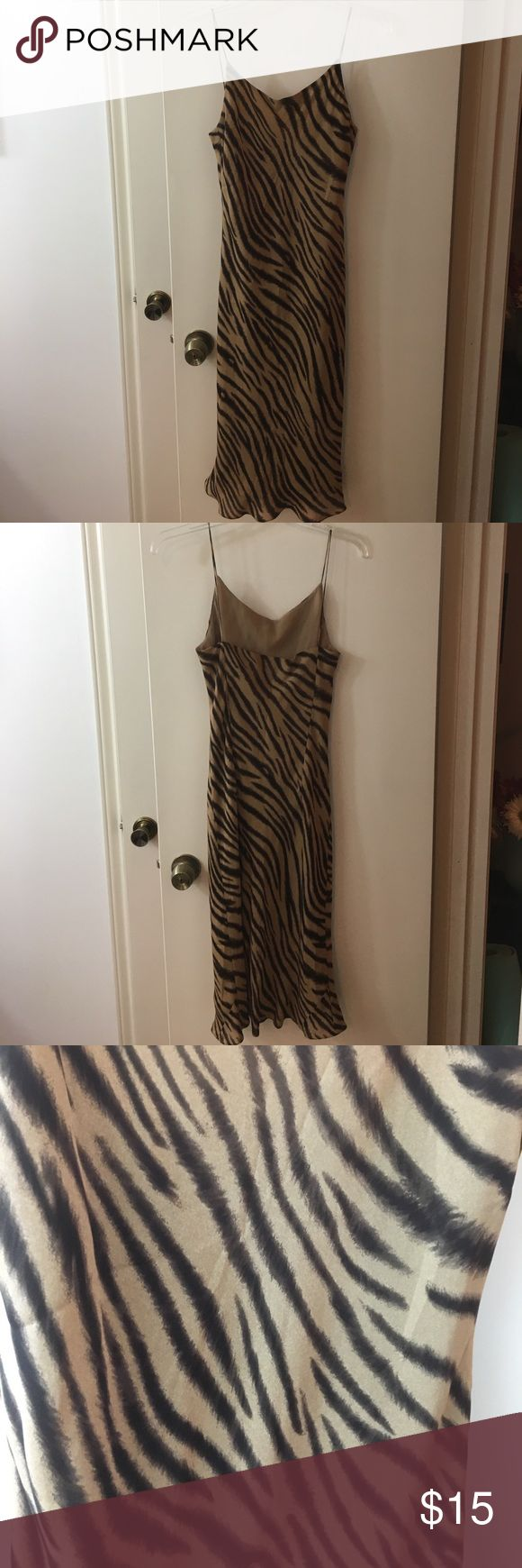 Tan zebra pattern dress Can be worn out for a night out with the girls or paired with a blazer for work. Excellent condition. Polyester material Jones New York Dresses