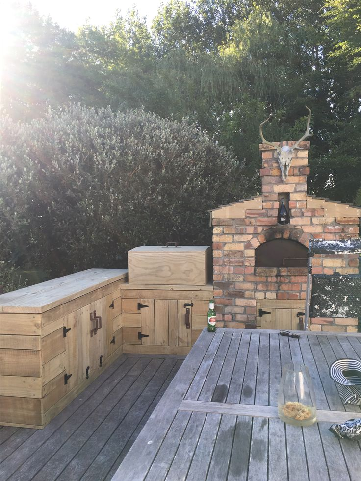 Outdoor pizza oven and prep space. BBQ hidden under hinged box....good job hubby!