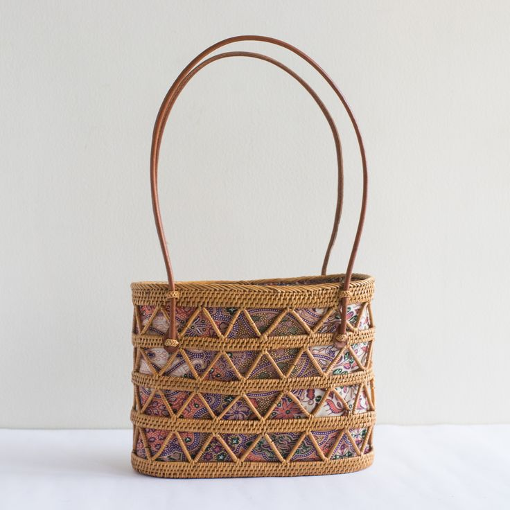 This unique, cute drawstring rattan bag is the perfect accessory, great for going to the beach, a quick walk in the park, or just a cozy afternoon in the cafe.