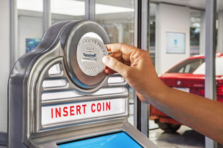After inserting a Carvana-branded coin into a slot of a car vending machine, buyers get to experience something memorable.