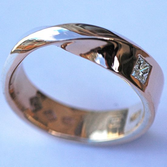 Classic mobius twist rose gold and silver ring with diamond.
