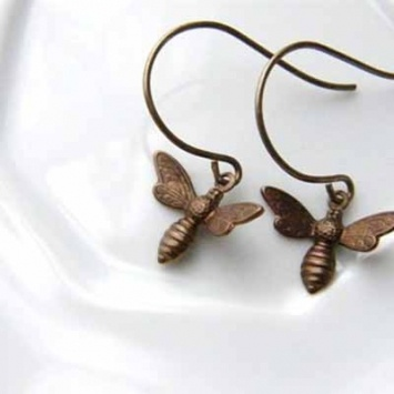 Bee Happy in these handmade earrings    These delicate honey bee earrings are handcrafted by Priscilla Mullins in Cincinnati, Ohio. Perfect for everyday, but also as a gift for your favorite bee keeper or garden friend.     Natural brass ear wires and drops.    $21.00