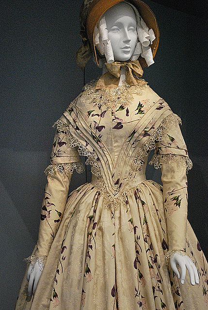 Dress: England, 1845-49 • Silk plain weave with warp-float patterning, printed, silk lace, and silk passementerie