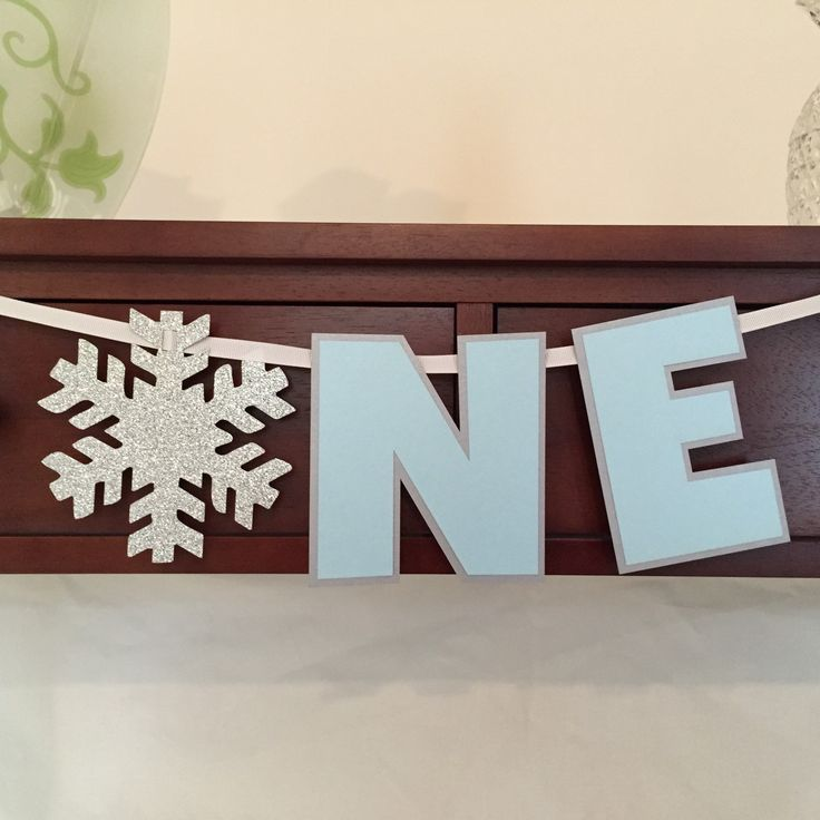 Winter Wonderland One High Chair Banner - Winter Onederland - I am One Banner - Snowflake Theme - Winter Party - Birthday Decoration  ***This item is MADE TO ORDER and ships in 3-5 business days from purchase***  This Winter Wonderland Themed ONE high chair banner is perfect for your childs first birthday party. It is laser cut from glitter and metallic card stock. It features a 5x 5 glitter snowflake that represents the O. Each letter is 5 tall and it is strung together with white grosgrain…