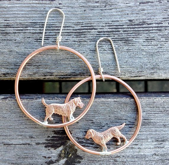 copper dogs ... earrings with vintage copper dogs on by MONOtekst