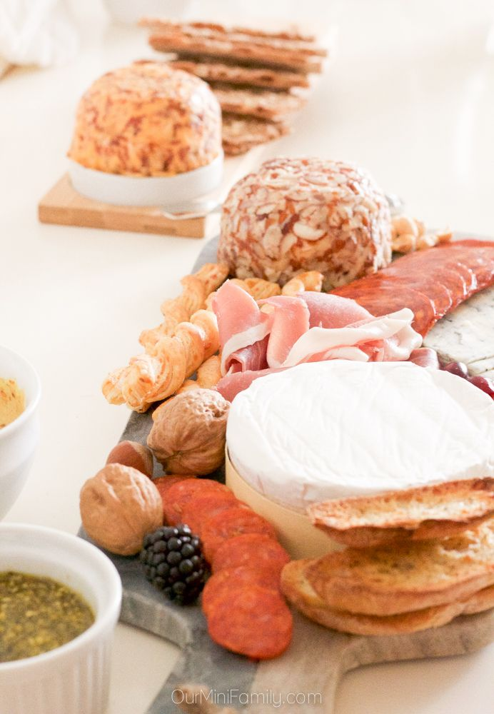 Host a Charcuterie Holiday Party this season for your friends, family, or even your co-workers! Enjoy an assortment of delicious foods, drinks, and Kaukauna Cheese!