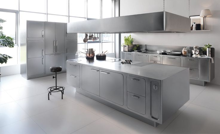 A Stainless Steel Kitchen Designed for At-Home Chefs - Design Milk (the other pics at the post have all sorts of built-in storage ideas)
