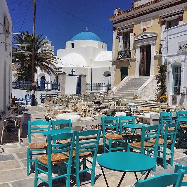 Perfect Cycladic church of Agios Athanasios with a nice square in front , at Serifos island (Σέριφος). Is the main square of Ano Chora village , where we find the City Hall and several traditional coffee shops .