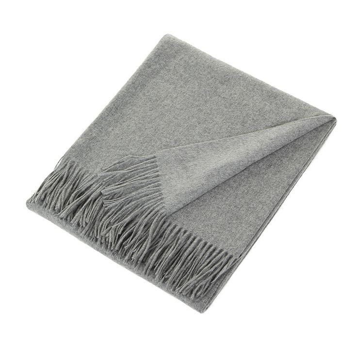 Add sophisticated chic to your home with this Trentino throw from Sofia Cashmere. Made from the finest pure cashmere, this 2 ply fringed throw is in a rich grey colour. A fabulous gift idea for any oc