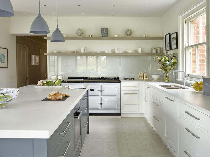 A Contemporary Classic hand painted kitchen. Glass splash backs, silestone worksurfaces. Total Control Aga and rubber lighting pendants. Domus porcelain floors.