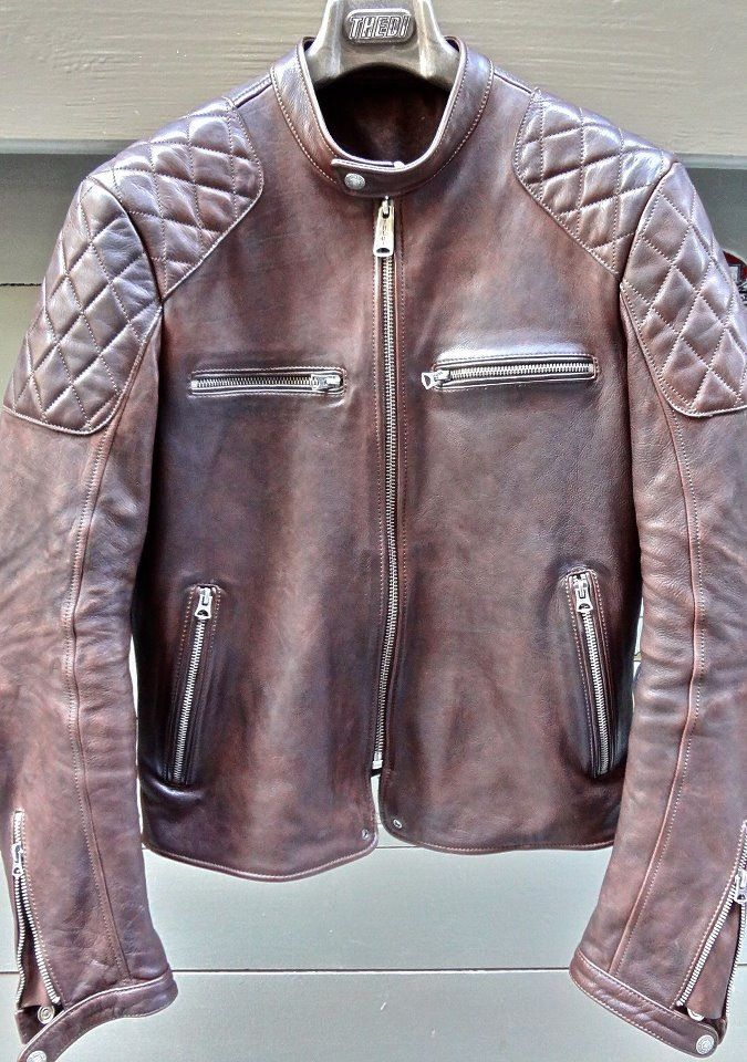 Leather moto jacket with quilted shoulders.