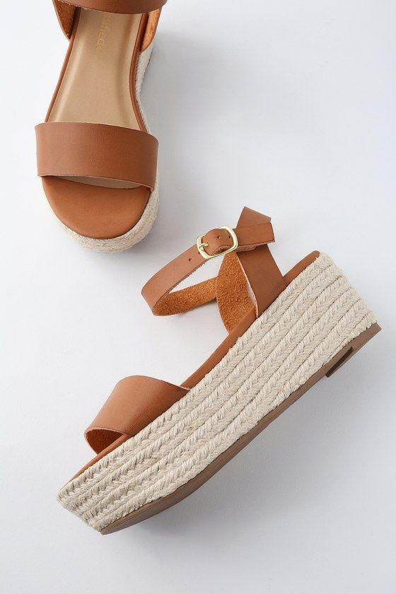2c5c7128ff7 Trek down to the water in style with the Corsa Tan Espadrille Flatform  Sandals! Sleek vegan leather covers a wide toe band