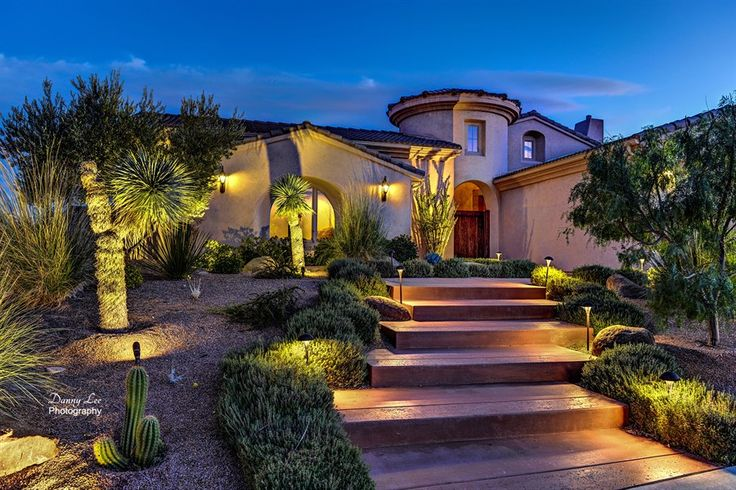 Nicely done landscape compliments style and architecture for Spanish landscape design