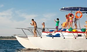 Groupon - Sunset or Groove Cruise with Unlimited Drinks and Hors D'oeuvres from It Wasn't Me Charters (Up to 53% Off) in Multiple Locations. Groupon deal price: $39