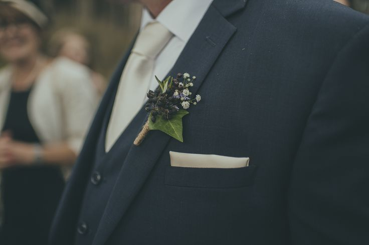 Love using seed pods and herbs in buttonholes.  This one is a combination of rosemary, gypsophila and ivy. Photo: Jake Thomas Photography