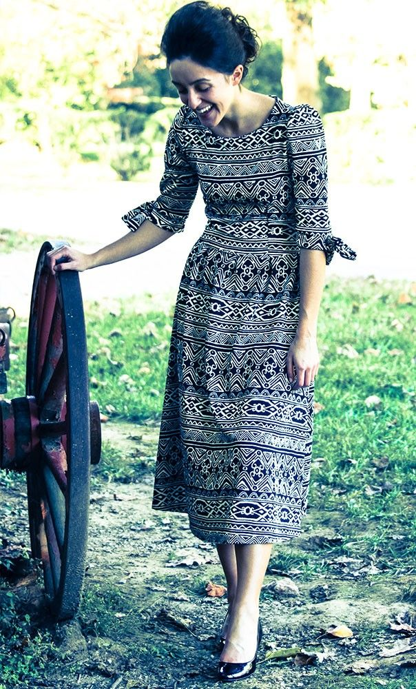 Tribal print half sleeve knit dress with bowknot sleeves and modest high neckline