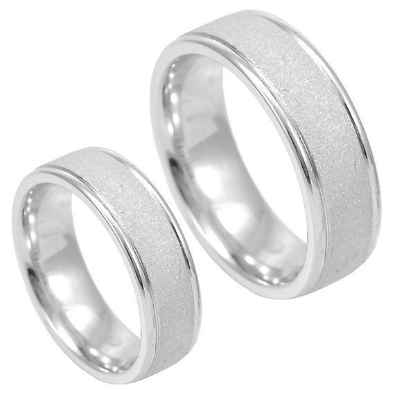 Contemporary Wedding Bands, A modern comfort ring in 14K white gold rounded gold band with sandblasted wavy lines design. COMPONENT  METAL: 14K White Gold  GRAM WEIGHT: 9.0gr WIDTH: 7.0 mm  DEPTH: 2.0 mm  STYLE CODE: LR3191-PB-015  The picture being shown are two separate items(Men and Ladies), listed description is for Ladies only. Separate pricing and listing for each.  This item can made in Brass, Silver, 18K white, yellow & rose gold, Palladium & Platinum. These are made to order and…