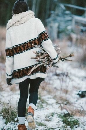Gathering firewood fashion girl outdoors winter wood boots sweater scarf