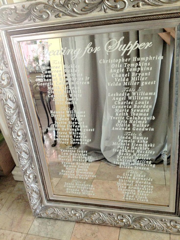 custom vinyl lettering on mirror for seating chart for