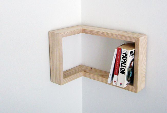 Corner bookshelf. Can you imagine ones stacked the length of the wall? Love this idea for a corner!