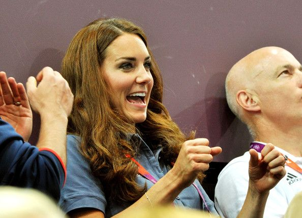 Catherine, Duchess of Cambridge cheers during the Women's Handball Preliminaries Group A match between Great Britain and Croatia. August 5, 2012