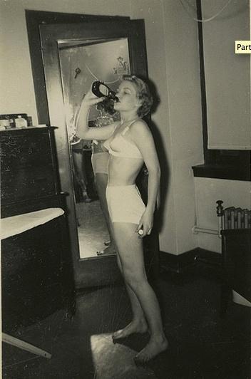 Drinking in her bullet bra and grandma panties.