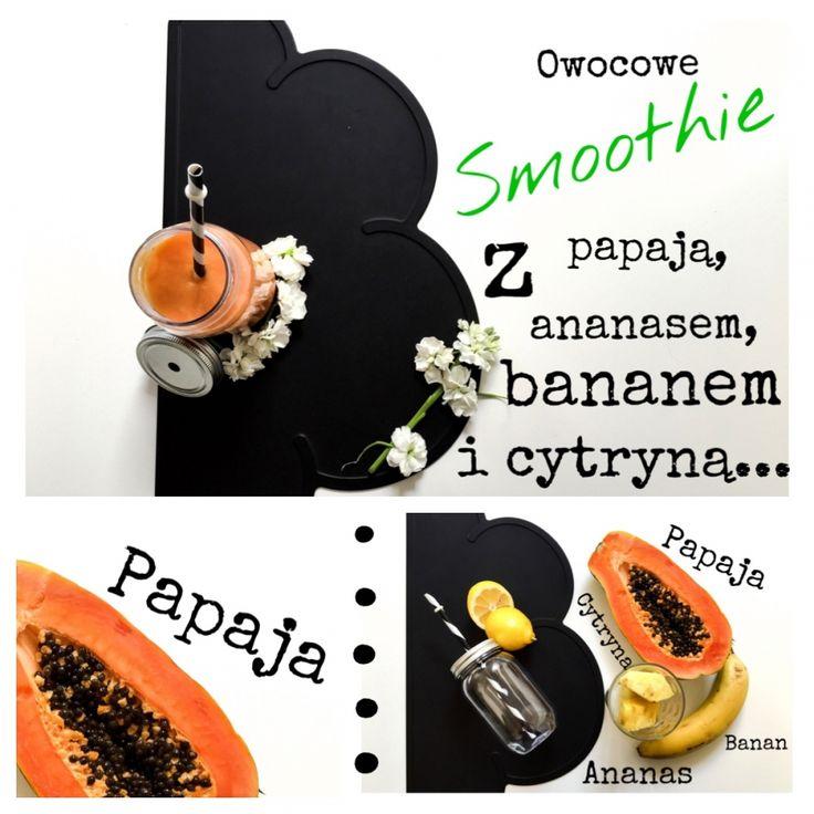 Fruit smoothie with papaya , pineapple , banana and lemon