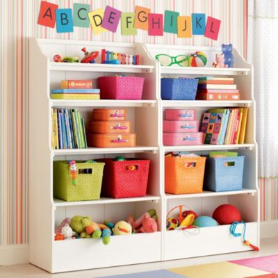 take regular book shelves, add simple board at the bottom to make a catch-all bin. So cute!