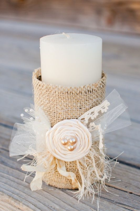 Burlap wrapped tin cans with candle inside. Very cheap wedding decorations...love the idea but not the flower. Maybe a raffia or twine ribbon with some color thrown in