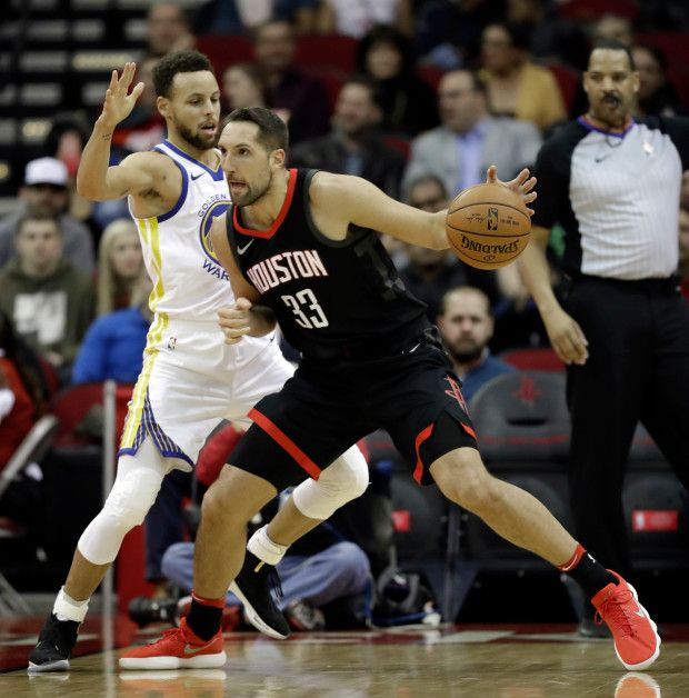 Houston Rockets' Ryan Anderson (33) drives toward the basket as Golden State Warriors' Stephen Curry defends during the first half of an NBA basketball game Thursday, Jan. 4, 2018, in Houston. (AP Photo/David J. Phillip)