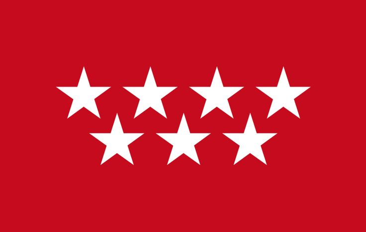 Bandera oficial de la Comunidad de Madrid. La comunidad se formo como comunidad autonoma oficialmente el 1 de Marzo el 1983. Antes hubo un debate si era mas apropriado segun la constitucion para Madrid ser parte de Castilla-La Mancha. Las estrellas representan la Ursa Mayor, pero tambien antiguos municipios de la Tierra de Madrid.