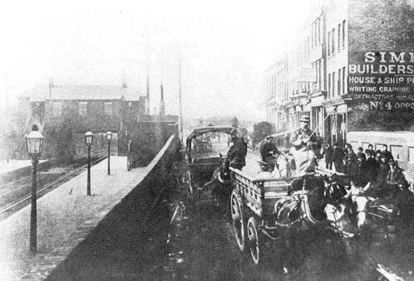 Canning Town Station (1st site), as seen from Victoria Dock Road, 1883. Originally called Barking Road station.