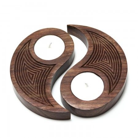 Carved wooden tea lights in a variety of shapes bring warmth and unique designs that make great housewarming or wedding gifts.