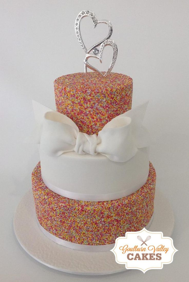 3 Tier Fondant & Sprinkles Wedding Cake with hand made Fondant Bow