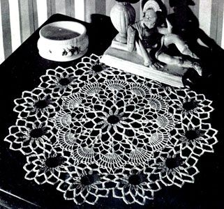 Excellent source for vintage doily patterns...thinking of making a table runner of vintage doilies sewn together....