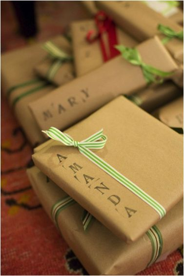 Like the idea of using letter stamps as the gift tag. :) Brown paper and a pretty bow...