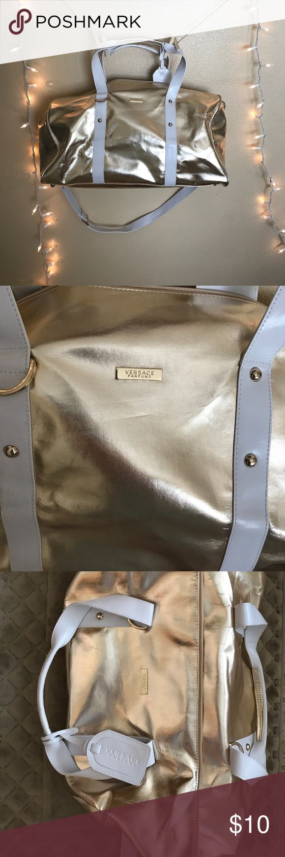 Versace duffle overnight bag Gold Gold and white Versace overnight duffle bag. Perfect for traveling. You could fit so much stuff in this bag. Basically brand new. Never used Versace Bags Travel Bags