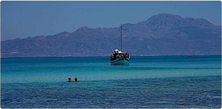 Ierapetra Chrissi Island - Gaidouronisi - Hrissi  One of the 81 uninhabited islands of Crete is Chrissi or Gaidouronisi (donkey) island. The residents of Ierapetra call it the Island as there is a special relationship between them.  Chrissi lies 8 miles away from Ierapetras coasts, in the Libyan sea. Chrissi is almost flat with colorful volcanic rocks covered in gold sand, purple shells and sand dunes. It is 5 km long and has an average width of 1 km and an average height of 10m.