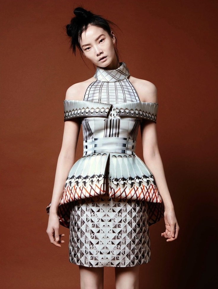 Dress with sculptural silhouette and mixed geometric patterned fashion prints