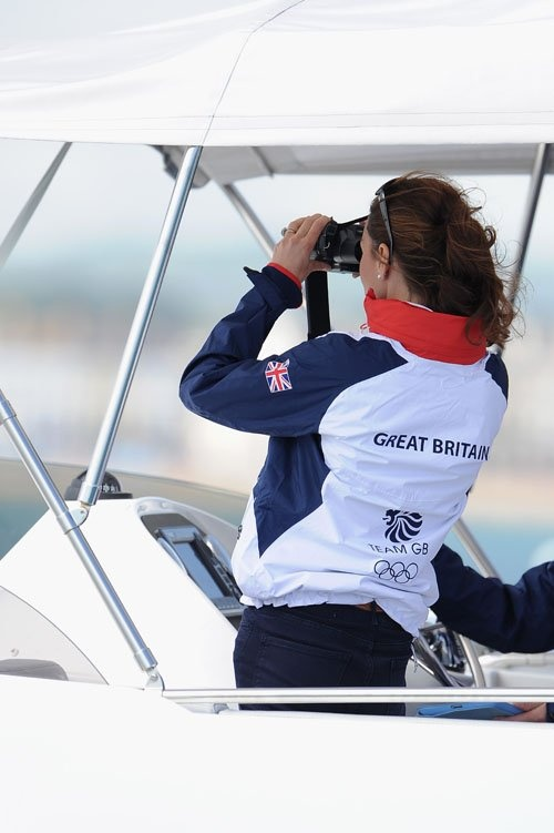 Kate uses binoculars to watch China's Xu Lijia take the Gold and Team GB's Alison Young come in 4th.