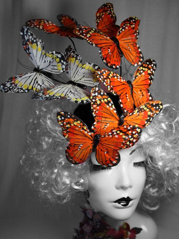 Hey, I found this really awesome Etsy listing at http://www.etsy.com/listing/166493627/effie-trinket-orange-feather-butterfly