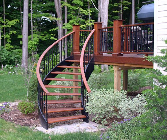 Two story decks with stairs deck spiral stairs from for Two story spiral staircase