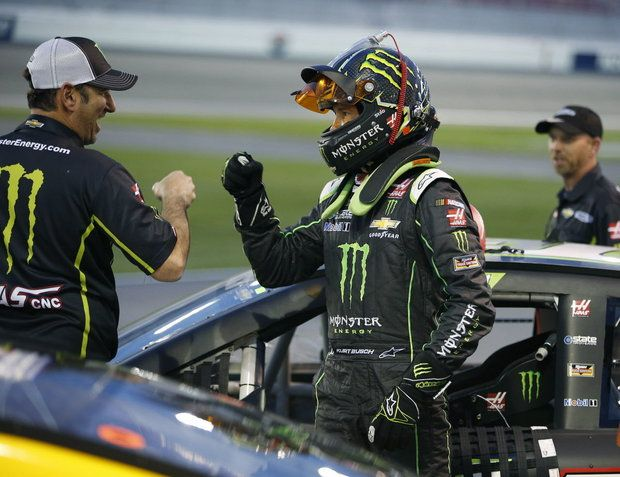 NASCAR Las Vegas Auto Racing  -   Kurt Busch, center, celebrates with teammates after winning the pole position during qualifying for the NASCAR Sprint Cup Series auto race Friday, March 4, 2016, in Las Vegas. (AP Photo/John Locher)